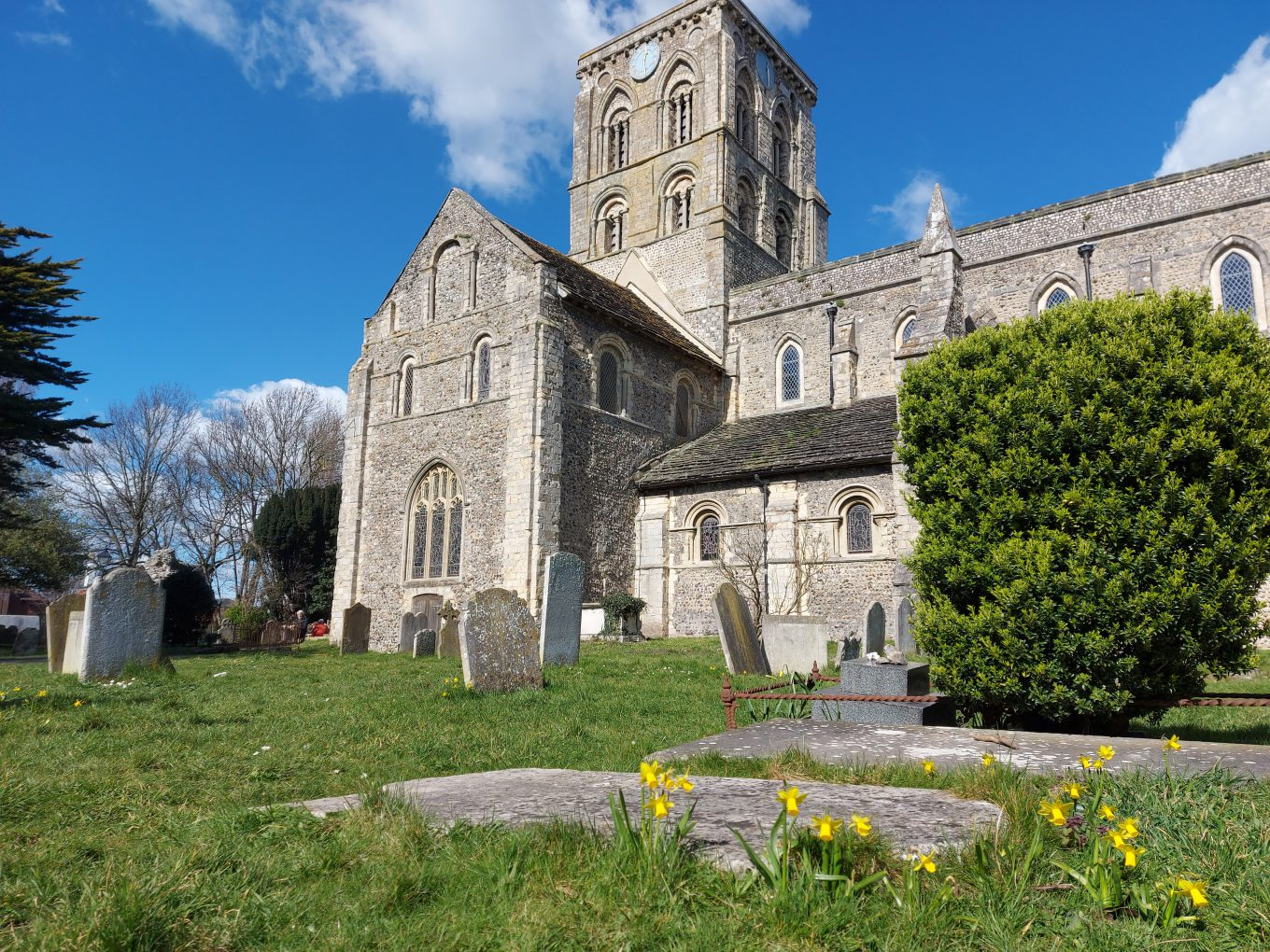 St Mary De Haura Church from the church yard on a Spring Day with Daffodils in the foreground